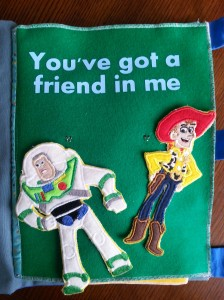 Woody and Buzz....embroidery files that were stitched onto felt, then backed with fabric.  They are both removable so there is a friend to play with!